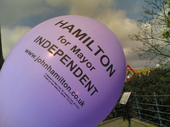 Political Balloon: An independent candidate for mayor campaigning by sticking balloons to lampposts near Lewisham station