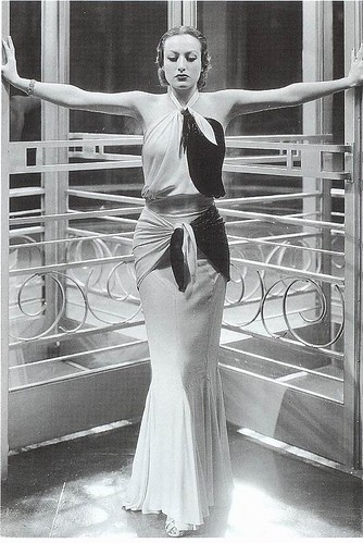 Joan Crawford wears a streamlined dress as Letty Lynton in 1932, designed by Adrian. It demonstrates the fashion for classical drapery with its bias-cutting, draping and wrap details.