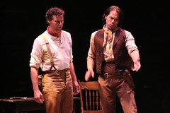 """Kevin Earley (left) as Jud Fry and Jeremiah James as Curly in the 2010 Music Circus production of """"Oklahoma!"""" at the Wells Fargo Pavilion July 27-August 1.  Photo by Charr Crail."""