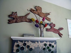 3 papermache dogs jumping