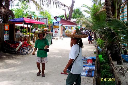 ambulant, food, fruit, peddler, Philippines, snack balance Boracay head walking women beach