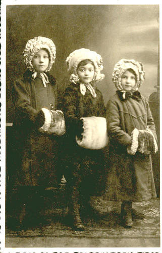 Little girls with hat and muff