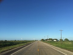 The Road Ahead. Day 152. Old Hwy 59 in Pierce, TX. This town is so tiny, only about 8 houses, a little island amid the highway and countryside. Slept beside the church because every inch of land down here is fenced off. #TheWorldWalk #travel #wwtheroadahe