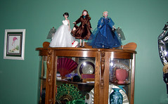 Different dolls on fan display case