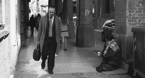 Panhandler vs Business man (via Ectofranz on Flickr)