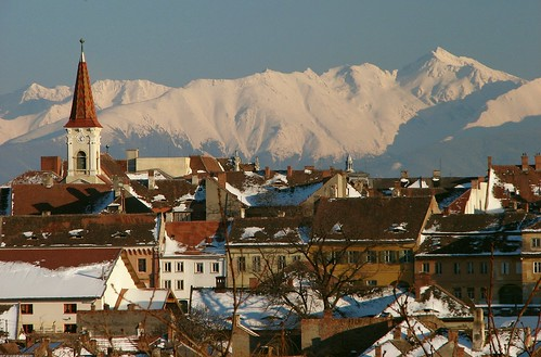 Reformed Church - Sibiu Romania with Negoiu Peak by CamilG.
