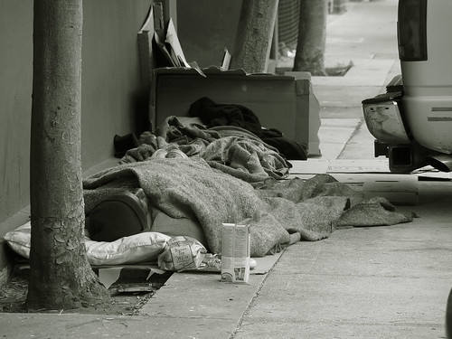 Homeless sleeping on the sidewalk