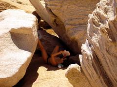 reader digested (isl_gr (away on an odyssey)) Tags: reading sandstone ikaria aegean greece hiker   mavri