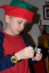 """IMG_4196: Alex Unwraps a Gift • <a style=""""font-size:0.8em;"""" href=""""http://www.flickr.com/photos/54494252@N00/8556031/"""" target=""""_blank"""">View on Flickr</a>"""