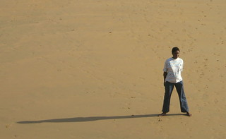 lonely kid on a beach ... standing
