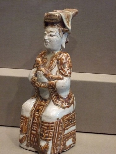 Seated figure with bird stoneware with underglaze painting 1500-1700 CE Thailand