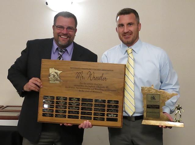 MWCA Executive Director Kip Lynk and Apple Valley Coach Josh Barlage. Coach Barlage accepted the MWCA Mr. Minnesota Wrestler Award for Gable Steveson. 180428AJF0709