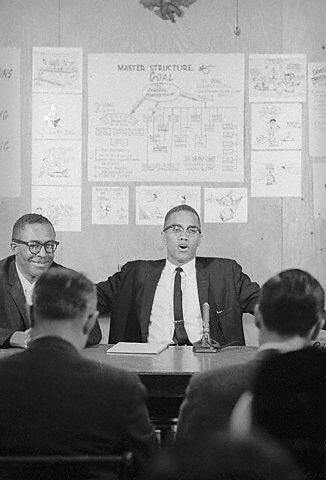 Atty. Milton Henry and Malcolm X in Detroit on April 12, 1964 by panafnewswire.
