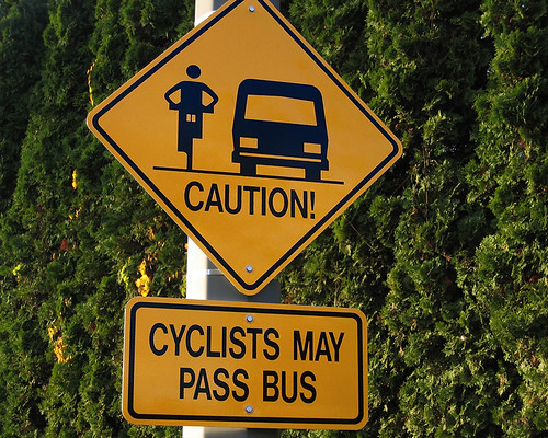 Cyclists may pass bus sign