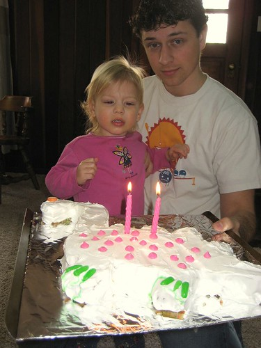 Jessica and dad with dinosaur cake