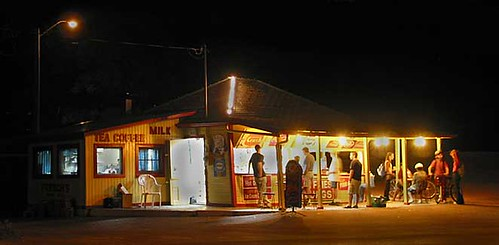 summer night at the hamburger stand in the park by gnawledge wurker