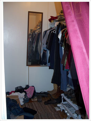 The before picture of the walk-in closet