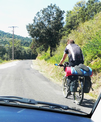 Cyclist toils up hill