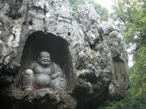 Happy Buddha in the rock