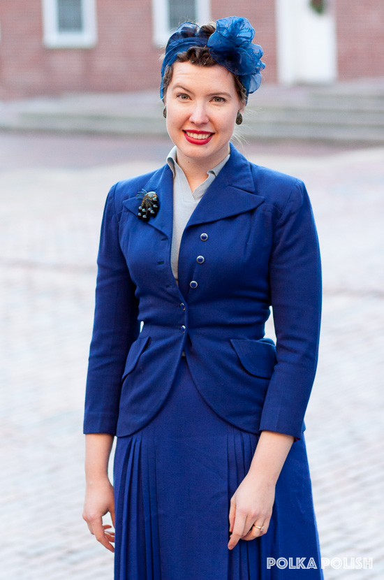 Vintage outfit featuring a royal blue suit with head scarf and black faux confetti lucite jewelry from Luxulite