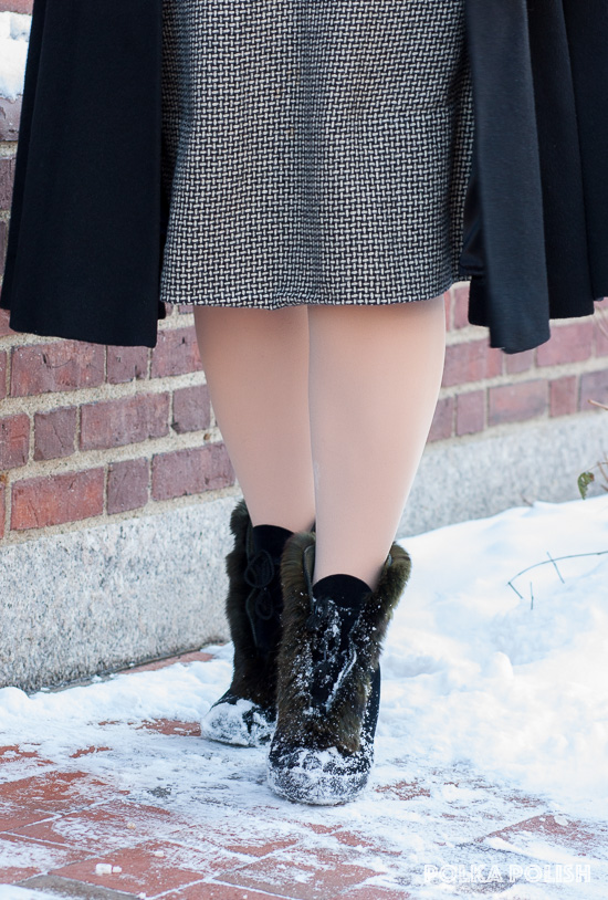 "Vintage black velvet ""Gaytees"" overshoes with rubber soles and rabbit fur trim paired with a black and white basketweave dress, a black coat, and a dusting of snow"