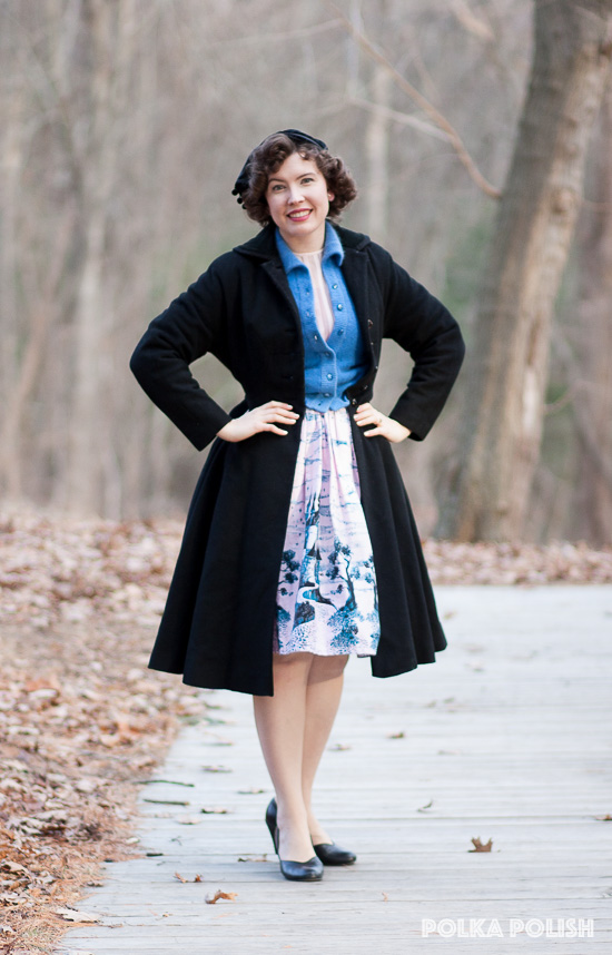 1950s inspired outfit in pink, blue, and black with novelty print castle skirt and a princess coat