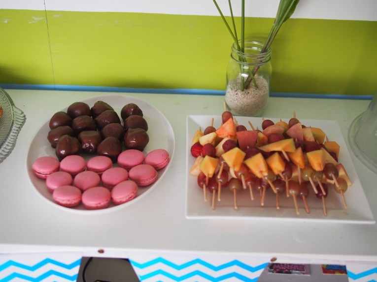 skewered fruits beside boutique pastry