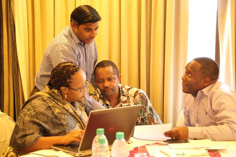 Left to right: Gaudiose Mujawamariya (AfricaRice), Kalimuthu Senthilkumar (AfricaRice), Elisha Mkandya (ILONGA Agricultural Research Institute) and Silvanus Mruma (NAFAKA) discuss the proposed work plan for the rice team year 2 activities
