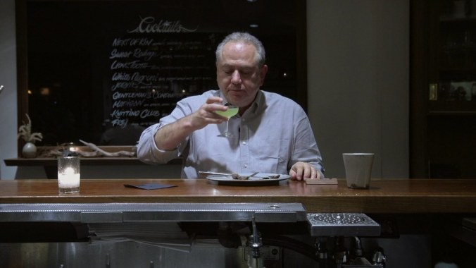 Steven Plotnicki sipping a cocktail after a satisfying meal of squab. (Credit: Fortissmo Films)