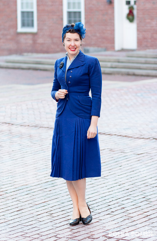 Vintage outfit featuring a royal blue suit with head scarf and black pumps