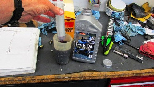Fork Oil, Measuring Cup and Syringe