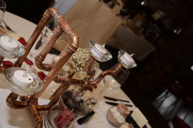 Geeky steampunk wedding with pipe centerpieces and steamy cake on @offbeatbride