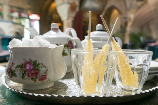 Tea with sticks of jaggery in a subterranean teahouse in the Kerman market.