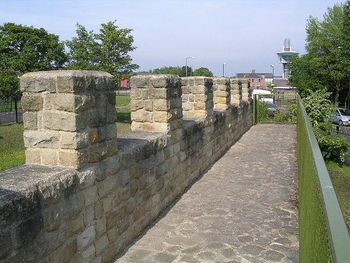 The reconstructed parapet and walkway on the curtain wall