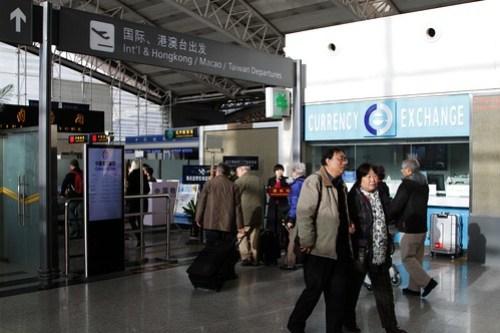 'International & Hong Kong / Macau / Taiwan Departures' sign at Xi'an Airport