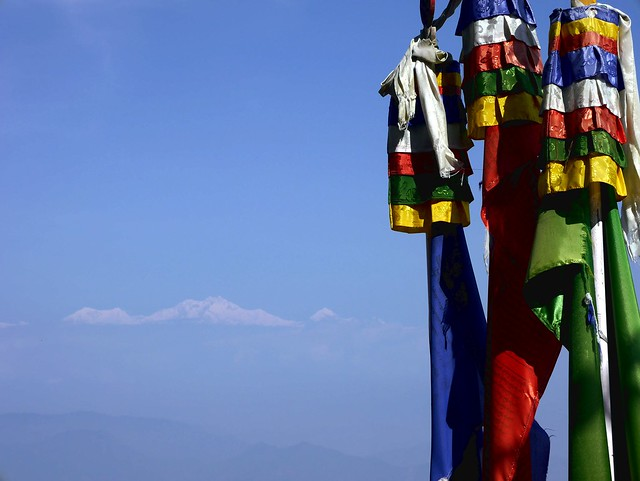 Himalayas behind colored flags
