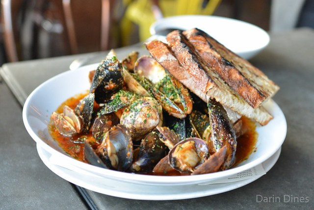 Mussels and Clams. housemade spicy 'nduja sausage. fennel seed. preserved orange. grilled bread.