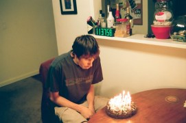 Kyle blowing out his birthday candles