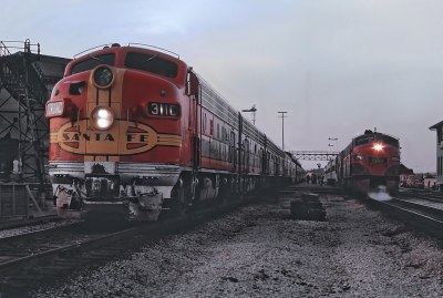 ATSF 311C  (F7A rebuilt to  CF7 2558) with the Texas Chief and GM&O 100A (E3A rebuilt to GMO E8Am 100, ex-Alton 100A nee B&O 50) with the Abe Lincoln at Joliet Union Station on April 1972