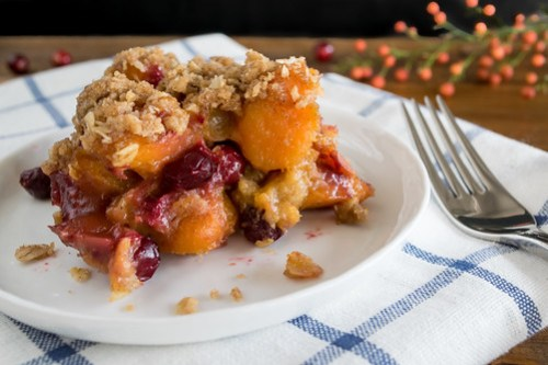 baked sweet potatoes and cranberries with a cinnamon-oat crumble
