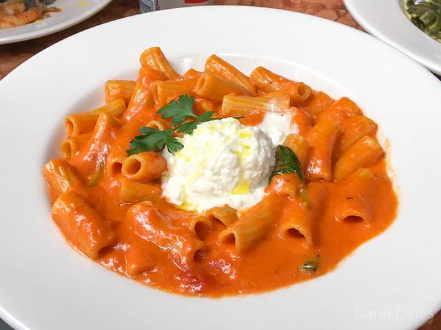 Rigatoni Pom'Amore rigatoni with a creamy tomato sauce topped with burrata