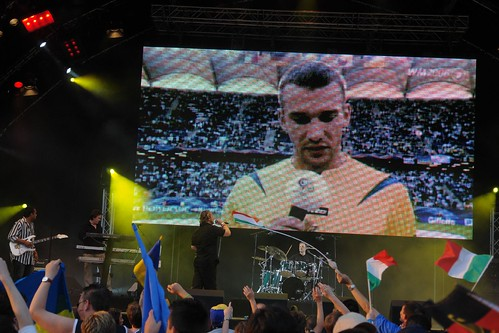 Andriy Shevchenko reading anti-racism statement, Simple Minds still on stage
