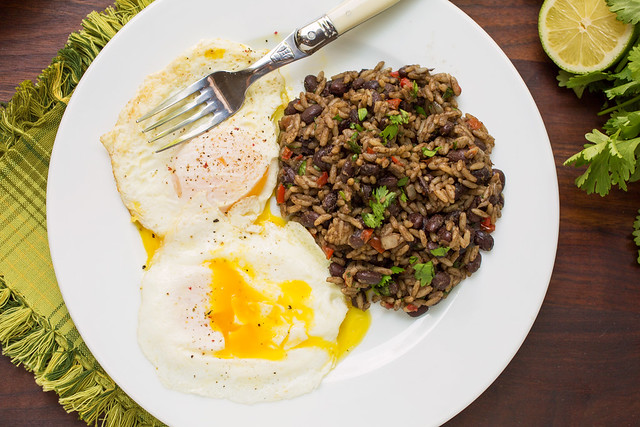 gallo pinto on plate with fried eggs