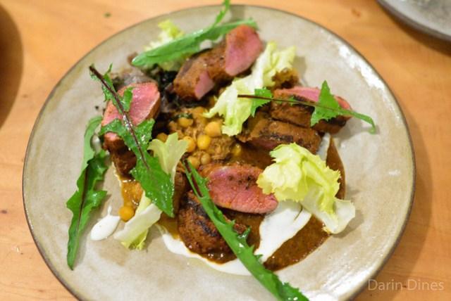 harissa lamb from don watson charred pepper vinaigrette and chickpeas