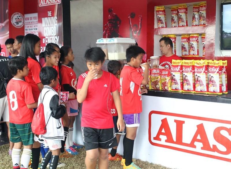 Alaska 20th Football Cup delegates line up for their Alaska milk