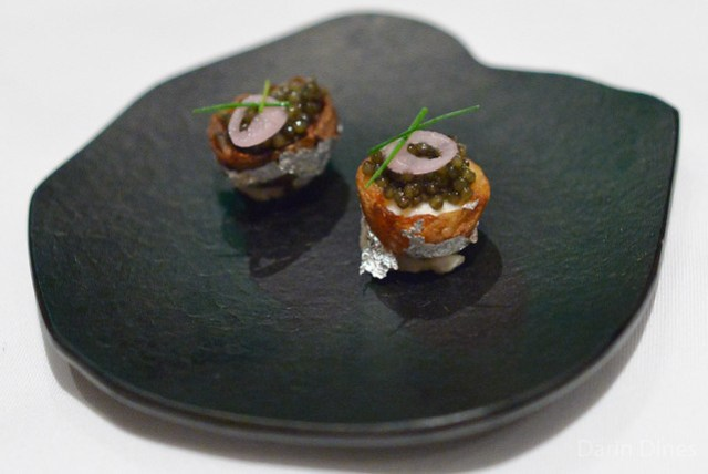 loaded potato with osetra caviar, sturgeon mousse and silver leaf (tusk)