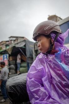 Woman on Bike with Rain Coat
