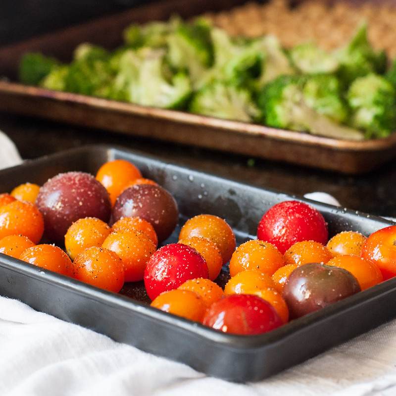 Roasting tomatoes for spicy Italian quinoa broccoli bowls