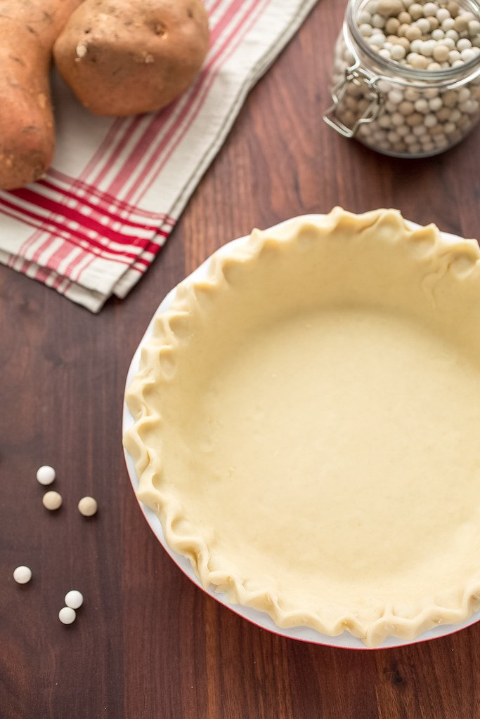 pie crust in plate with weights