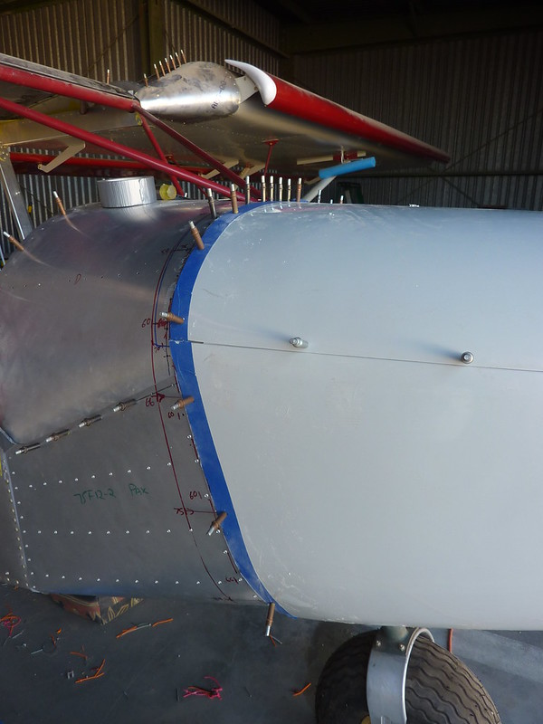 Drilled fuselage holes in cowl
